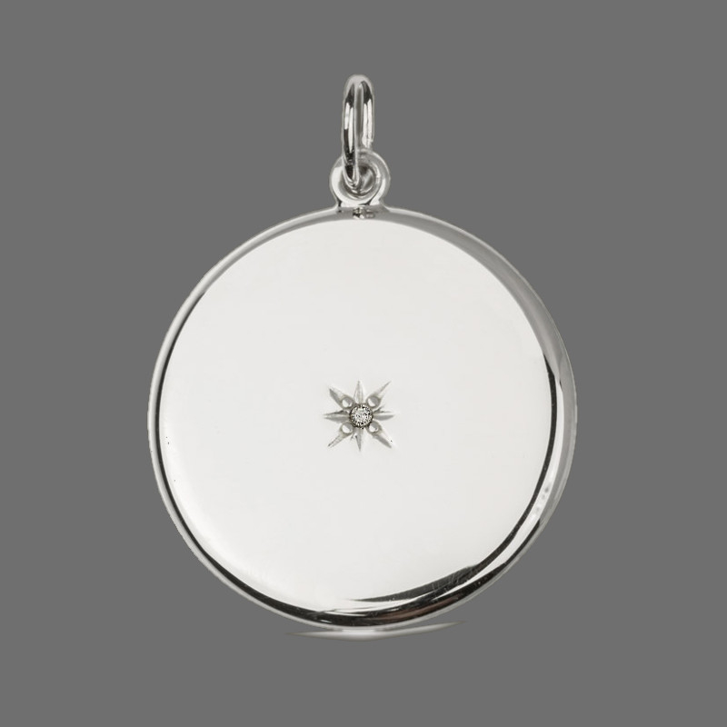 """""""North Star"""" Locket Pendant round sterling silver with a stone"""